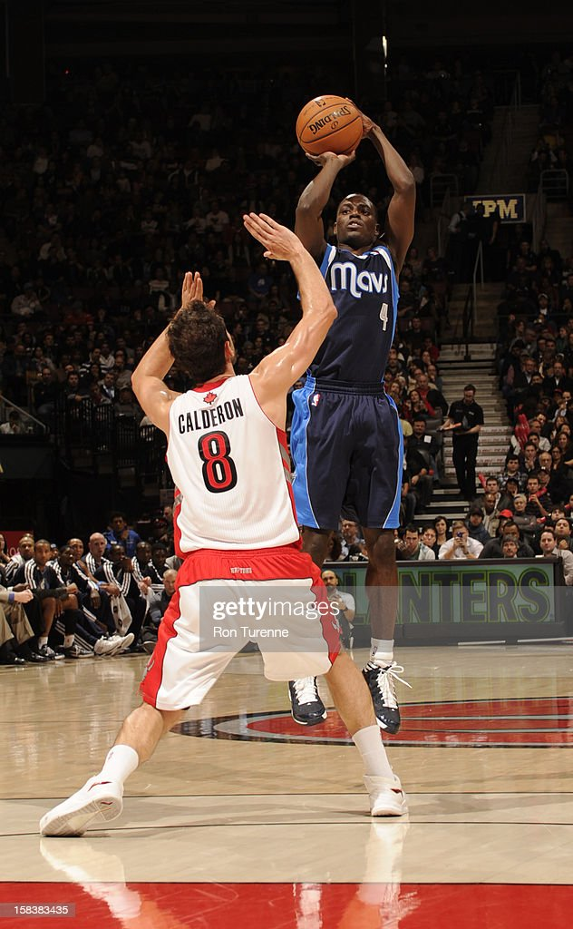 <a gi-track='captionPersonalityLinkClicked' href=/galleries/search?phrase=Darren+Collison&family=editorial&specificpeople=699031 ng-click='$event.stopPropagation()'>Darren Collison</a> #4 of the Dallas Mavericks takes a shot over Jose Calderon #8 of the Toronto Raptors on December 14, 2012 at the Air Canada Centre in Toronto, Ontario, Canada.
