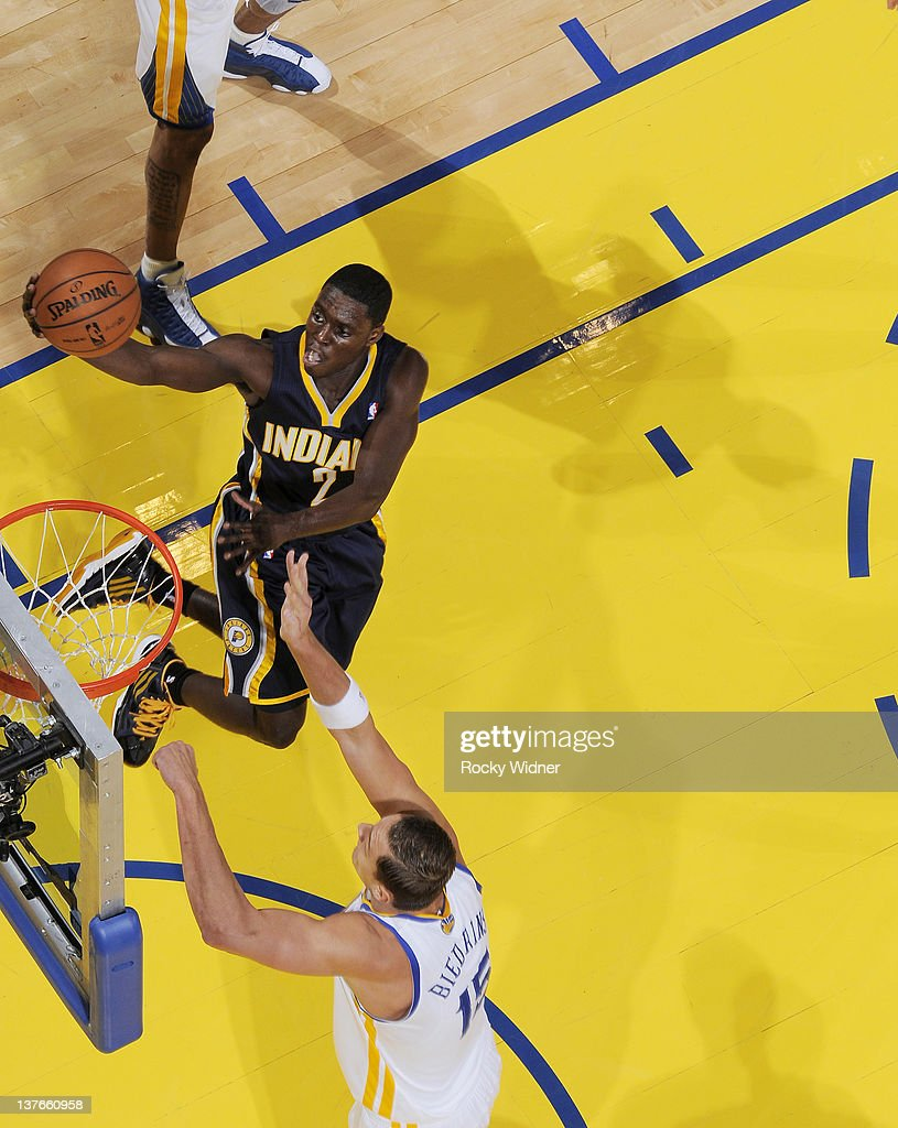 <a gi-track='captionPersonalityLinkClicked' href=/galleries/search?phrase=Darren+Collison&family=editorial&specificpeople=699031 ng-click='$event.stopPropagation()'>Darren Collison</a> #2 of the Indiana Pacers attempts to lay the ball up over <a gi-track='captionPersonalityLinkClicked' href=/galleries/search?phrase=Andris+Biedrins&family=editorial&specificpeople=204473 ng-click='$event.stopPropagation()'>Andris Biedrins</a> #15 of the Golden State Warriors on January 20, 2012 at Oracle Arena in Oakland, California.