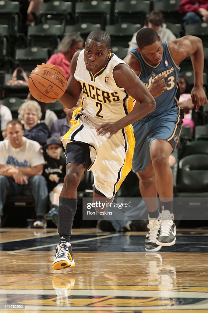 <a gi-track='captionPersonalityLinkClicked' href=/galleries/search?phrase=Darren+Collison&family=editorial&specificpeople=699031 ng-click='$event.stopPropagation()'>Darren Collison</a> #2 of the Indiana Pacers pushes the ball up court against the Washington Wizards during the game on April 6, 2011 at Conseco Fieldhouse in Indianapolis, Indiana.