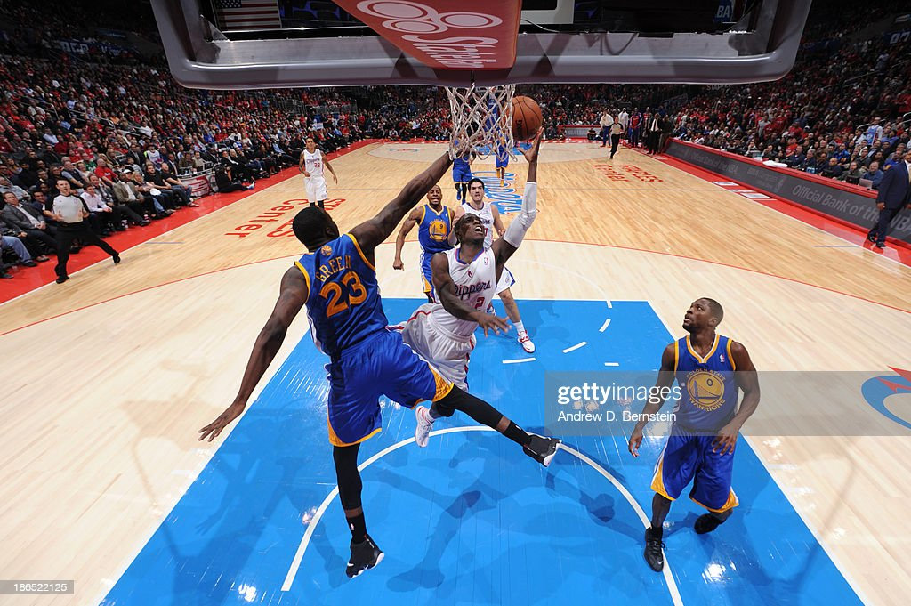 <a gi-track='captionPersonalityLinkClicked' href=/galleries/search?phrase=Darren+Collison&family=editorial&specificpeople=699031 ng-click='$event.stopPropagation()'>Darren Collison</a> #2 of the Los Angeles Clippers attempts a shot against <a gi-track='captionPersonalityLinkClicked' href=/galleries/search?phrase=Draymond+Green&family=editorial&specificpeople=5628054 ng-click='$event.stopPropagation()'>Draymond Green</a> #23 of the Golden State Warriors at STAPLES Center on October 31, 2013 at in Los Angeles, California.