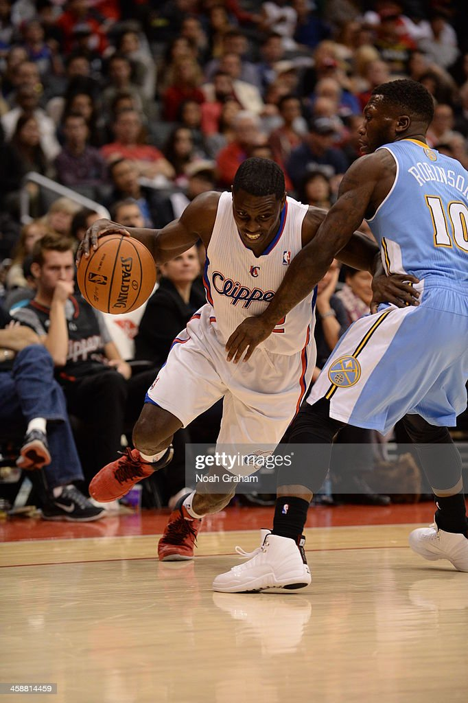 <a gi-track='captionPersonalityLinkClicked' href=/galleries/search?phrase=Darren+Collison&family=editorial&specificpeople=699031 ng-click='$event.stopPropagation()'>Darren Collison</a> #2 of the Los Angeles Clippers drives to the basket during a game against the Denver Nuggets at STAPLES Center on December 21, 2013 in Los Angeles, California.