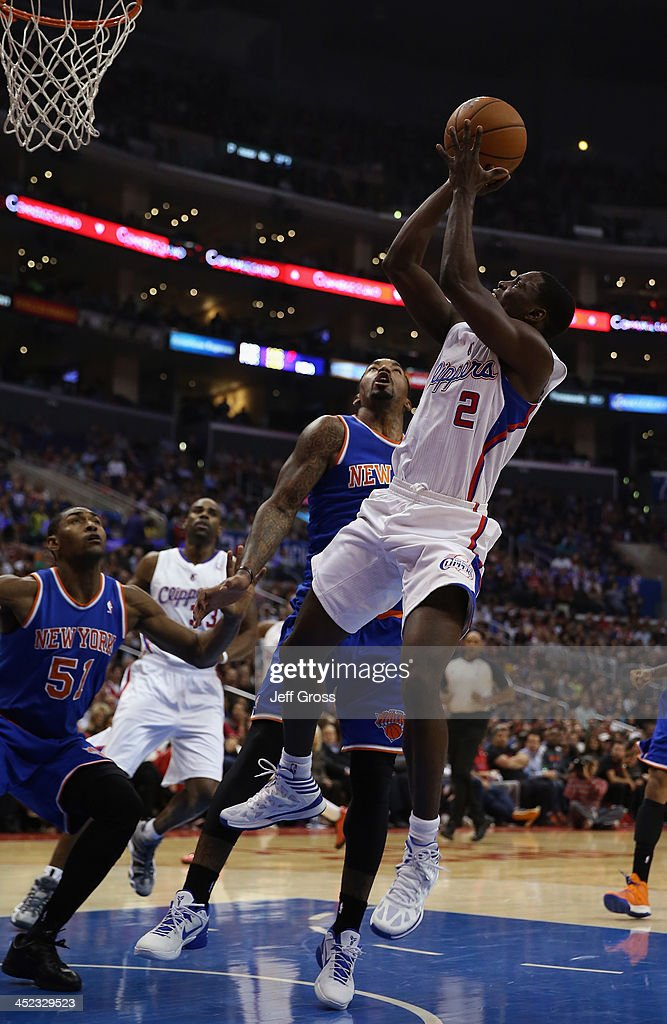 Darren Collison #2 of the Los Angeles Clippers drives to the basket while defended by J.R. Smith #8 of the New York Knicks in the second half at Staples Center on November 27, 2013 in Los Angeles, California. The Clippers defeated the Knicks 93-80.