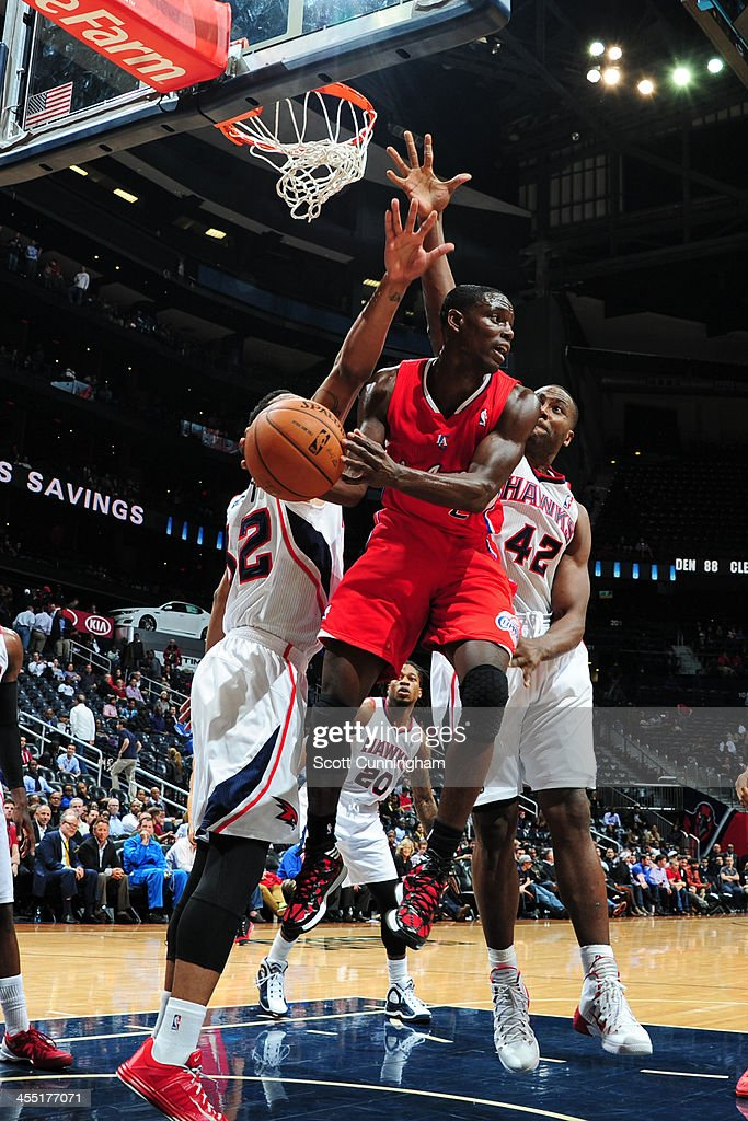 <a gi-track='captionPersonalityLinkClicked' href=/galleries/search?phrase=Darren+Collison&family=editorial&specificpeople=699031 ng-click='$event.stopPropagation()'>Darren Collison</a> #2 of the Los Angeles Clippers grabs the rebound against the Atlanta Hawks on December 4, 2013 at Philips Arena in Atlanta, Georgia.