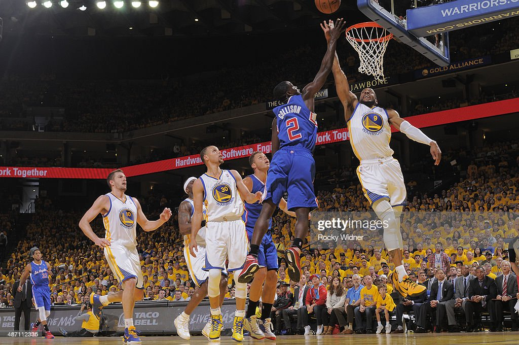 Darren Collison #2 of the Los Angeles Clippers rebounds against Andre Iguodala #9 of the Golden State Warriors in Game Four of the Western Conference Quarterfinals during the 2014 NBA Playoffs at Oracle Arena on April 27, 2014 in Oakland, California.