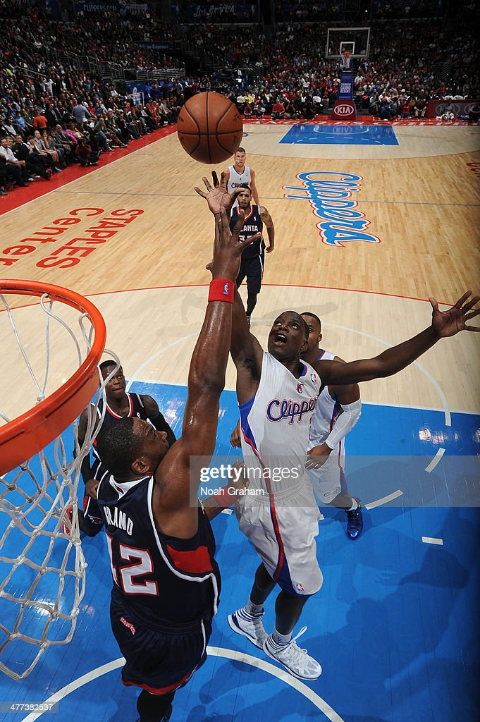 Darren Collison #2 of the Los Angeles Clippers shoots against Elton Brand #42 of the Atlanta Hawks at Staples Center on March 8, 2014 in Los Angeles, California.