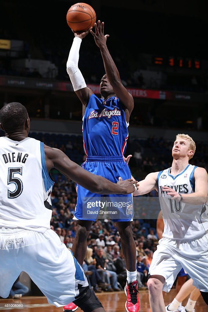 <a gi-track='captionPersonalityLinkClicked' href=/galleries/search?phrase=Darren+Collison&family=editorial&specificpeople=699031 ng-click='$event.stopPropagation()'>Darren Collison</a> #2 of the Los Angeles Clippers takes a shot against the Minnesota Timberwolves on March 31, 2014 at Target Center in Minneapolis, Minnesota.