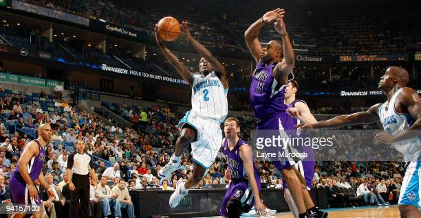 Darren Collison of the New Orleans Hornets shoots against Kenny Thomas of the Sacramento Kings on December 8 2009 at the New Orleans Arena in New...