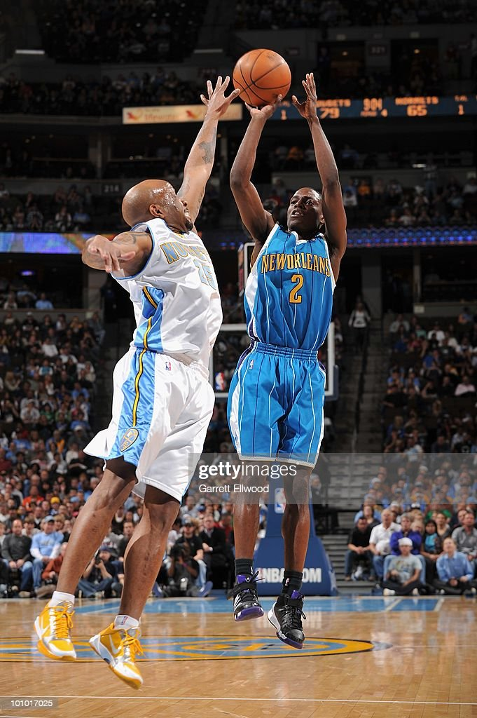 Darren Collison #2 of the New Orleans Hornets takes a jump shot against Anthony Carter #25 of the Denver Nuggets during the game on March 18, 2010 at the Pepsi Center in Denver, Colorado. The Nuggets won 93-80.
