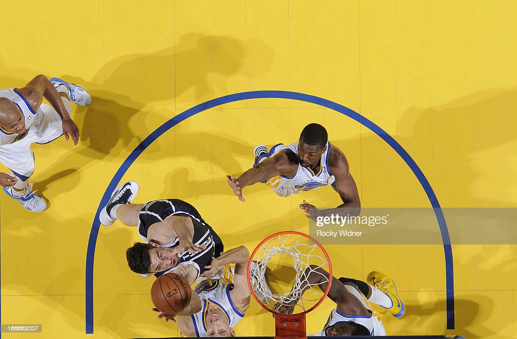 <a gi-track='captionPersonalityLinkClicked' href=/galleries/search?phrase=Darren+Collison&family=editorial&specificpeople=699031 ng-click='$event.stopPropagation()'>Darren Collison</a> #4 of the Oklahoma City Thunder rebounds against Stephen Curry #30 of the Golden State Warriors on April 11, 2013 at Oracle Arena in Oakland, California.