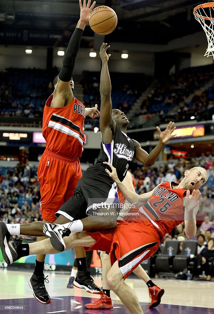 Darren Collison #7 of the Sacramento Kings drives on Steve Blake #25 of the Portland Trail Blazers and gets called for an offensive foul during the first half of their game at Sleep Train Arena on October 31, 2014 in Sacramento, California.