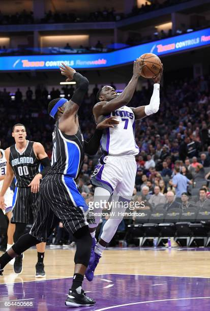 Darren Collison of the Sacramento Kings goes up to shoot over Terrence Ross of the Orlando Magic during an NBA basketball game at Golden 1 Center on...