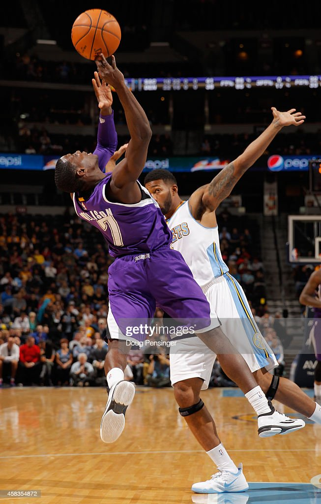 <a gi-track='captionPersonalityLinkClicked' href=/galleries/search?phrase=Darren+Collison&family=editorial&specificpeople=699031 ng-click='$event.stopPropagation()'>Darren Collison</a> #7 of the Sacramento Kings is fouled by <a gi-track='captionPersonalityLinkClicked' href=/galleries/search?phrase=Alonzo+Gee&family=editorial&specificpeople=801443 ng-click='$event.stopPropagation()'>Alonzo Gee</a> #1 of the Denver Nuggets at Pepsi Center on November 3, 2014 in Denver, Colorado.