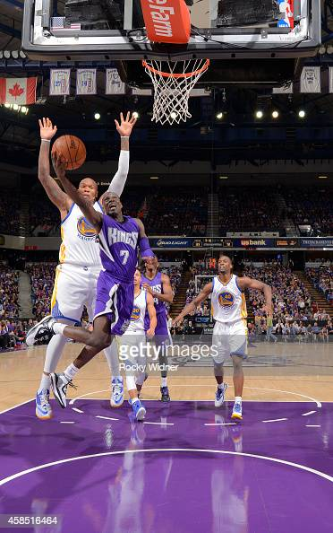 Darren Collison of the Sacramento Kings shoots a layup against Marreese Speights of the Golden State Warriors on October 29 2014 at Sleep Train Arena...