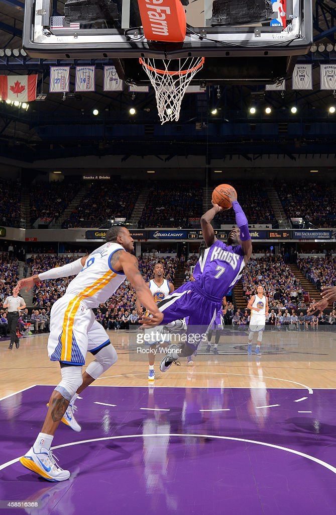 Darren Collison of the Sacramento Kings shoots against Andre Iguodala of the Golden State Warriors on October 29 2014 at Sleep Train Arena in...