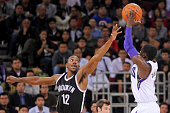 Darren Collison of the Sacramento Kings shoots in front of Marquis Teague of the Brooklyn Nets during the game between the Brooklyn Nets and the...