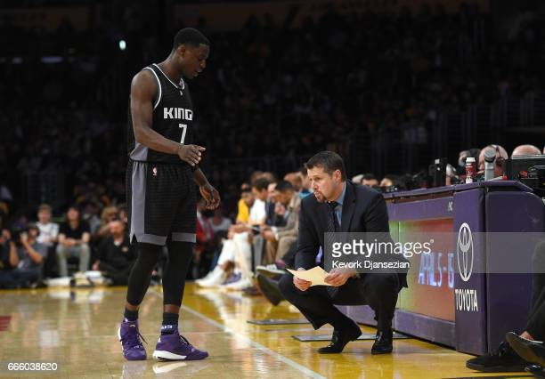 Darren Collison of the Sacramento Kings speaks with head coach David Joerger of the Sacramento Kings during the second half of the basketball game...