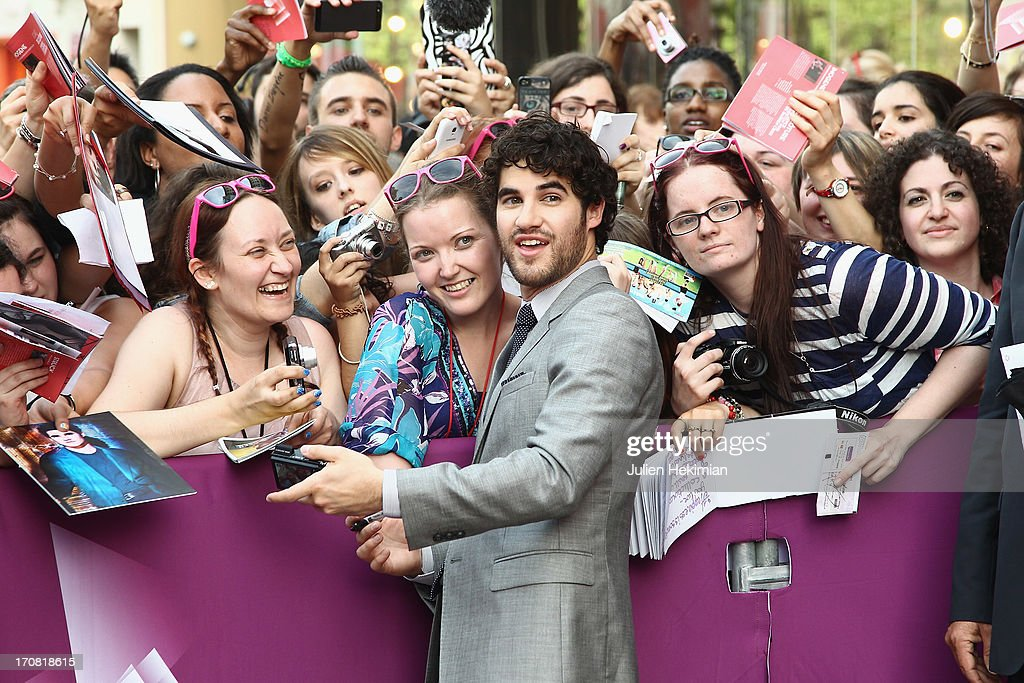 <a gi-track='captionPersonalityLinkClicked' href=/galleries/search?phrase=Darren+Criss&family=editorial&specificpeople=7341435 ng-click='$event.stopPropagation()'>Darren Criss</a> poses with fans during the 'Imogene' Paris Premiere As Part of The Champs Elysees Film Festival 2013 at Publicis Champs Elysees on June 18, 2013 in Paris, France.