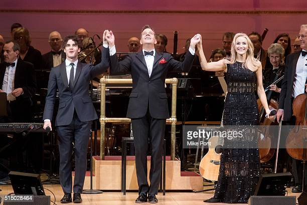 Darren Criss Steven Reineke and Betsy Wolfe perform during The New York Pops Darren Criss and Betsy Wolfe in Concert at Carnegie Hall on March 11...