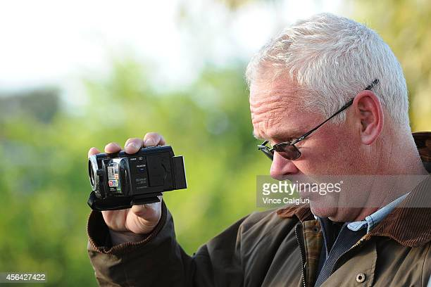 Darren Dance from Australian Thoroughbred Bloodstock filming Dandino after a trackwork session at Werribee Racecourse on October 1 2014 in Melbourne...
