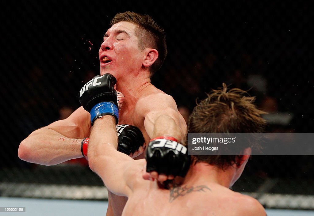 Darren Elkins (R) connects on a punch to the face of Steven Siler in their featherweight bout during UFC 154 on November 17, 2012 at the Bell Centre in Montreal, Canada.