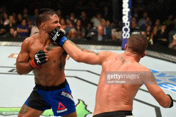 Darren Elkins punches Dennis Bermudez in their featherweight bout during the UFC Fight Night event inside the Nassau Veterans Memorial Coliseum on...