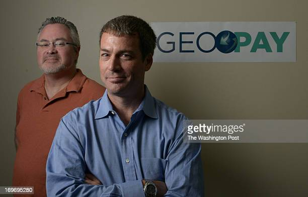 Darren Feeley right is the chairman and CEO of GeoPay a Restonbased company that operates mobile banking in developing countries Sean Kidder left is...