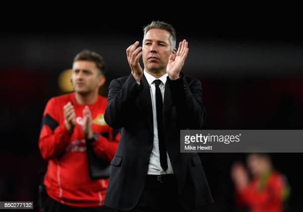 Darren Ferguson manager of Doncaster Rovers shows appreciation to the fans after the Carabao Cup Third Round match between Arsenal and Doncaster...