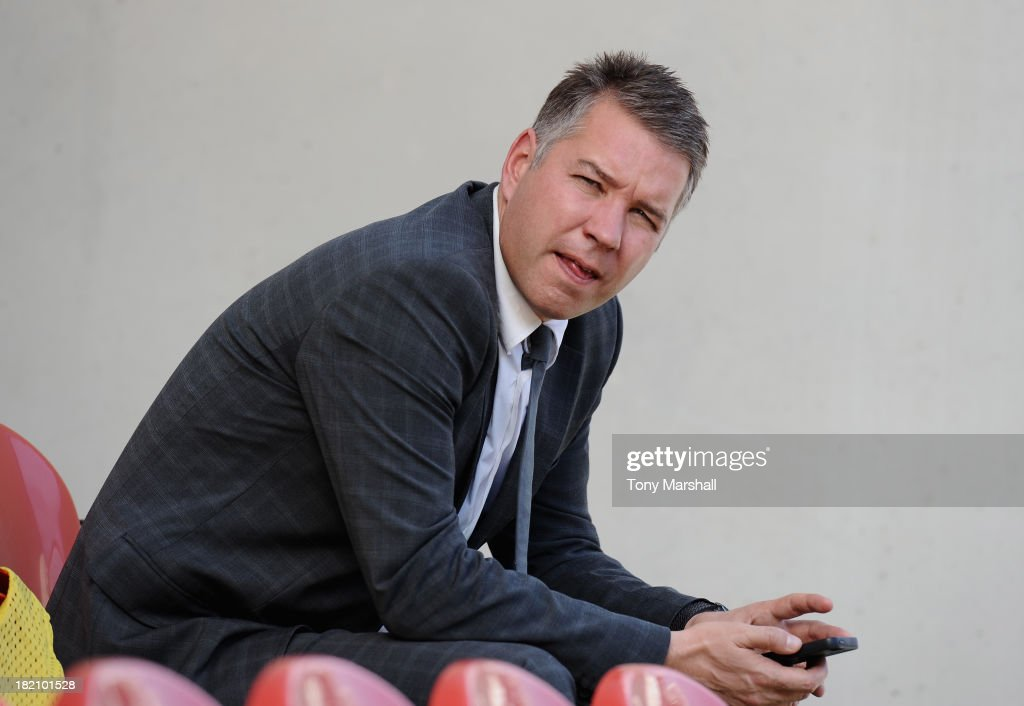 <a gi-track='captionPersonalityLinkClicked' href=/galleries/search?phrase=Darren+Ferguson&family=editorial&specificpeople=2316983 ng-click='$event.stopPropagation()'>Darren Ferguson</a>, manager of Peterborough United in the dugout before the Sky Bet League One match between Rotherham United and Peterborough United at The New York Stadium on September 28, 2013 in Rotherham, England.