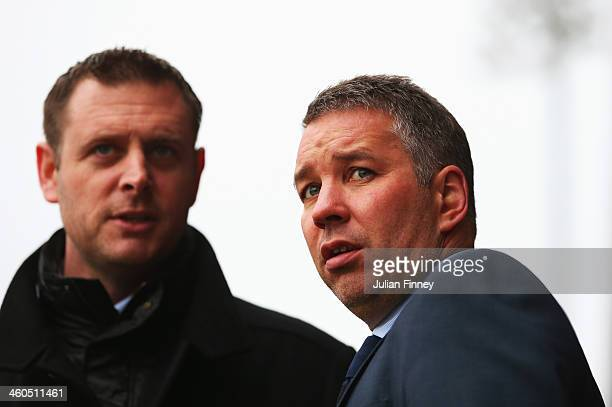 Darren Ferguson manager of Peterborough United looks on with Chairman Darragh MacAnthony prior to the Budweiser FA Cup third round match between...