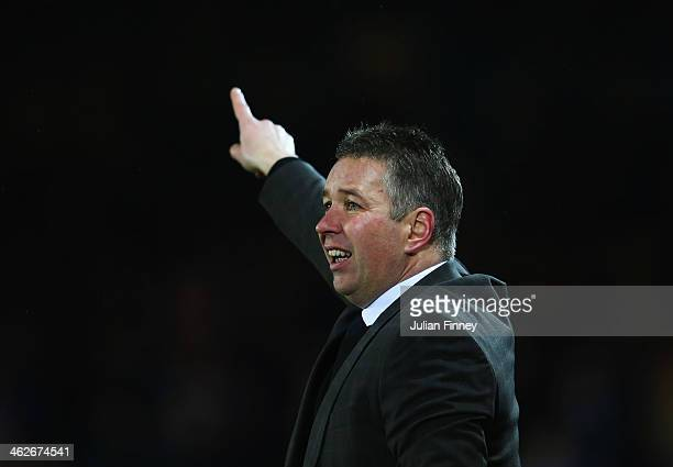 Darren Ferguson manager of Peterborough United signals during the FA Cup with Budweiser Third round replay match between Peterborough United and...