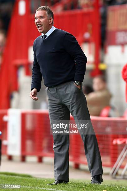 Darren Ferguson the manager of Peterborough United shouts from the sideline during the Sky Bet League One match between Crawley Town and Peterborough...