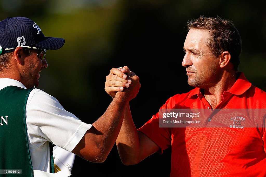 Darren Fichardt (red shirt) of South Africa and his caddie, Jady de Beer celebrate after they win the Africa Open at East London Golf Club on February 17, 2013 in East London, South Africa.