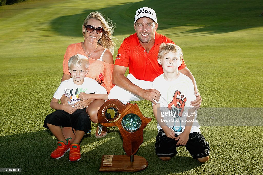 Darren Fichardt of South Africa and his family celebrate with the trophy after he wins the Africa Open at East London Golf Club on February 17, 2013 in East London, South Africa.