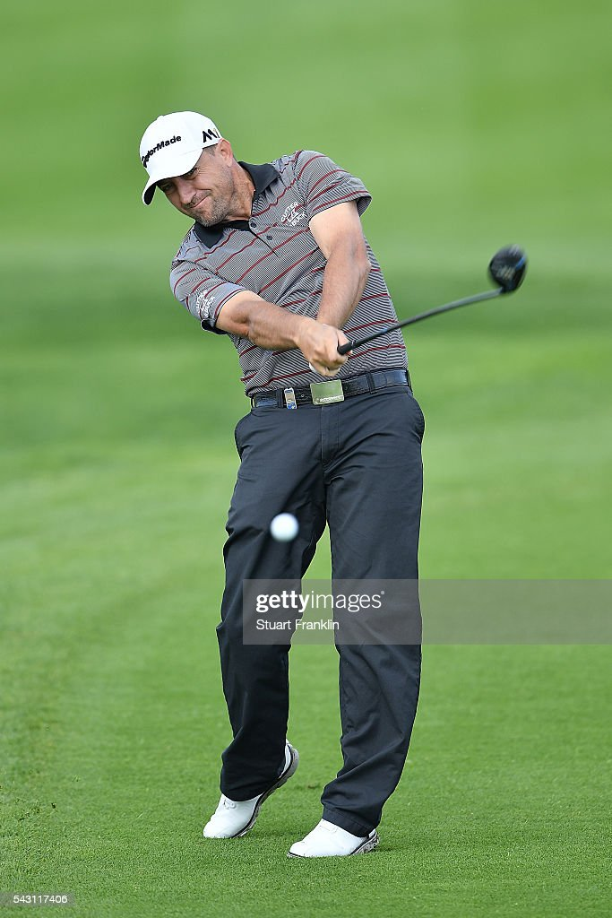 <a gi-track='captionPersonalityLinkClicked' href=/galleries/search?phrase=Darren+Fichardt&family=editorial&specificpeople=549518 ng-click='$event.stopPropagation()'>Darren Fichardt</a> of South Africa hits an approach shot during the rain delayed third round of the BMW International Open at Gut Larchenhof on June 26, 2016 in Cologne, Germany.