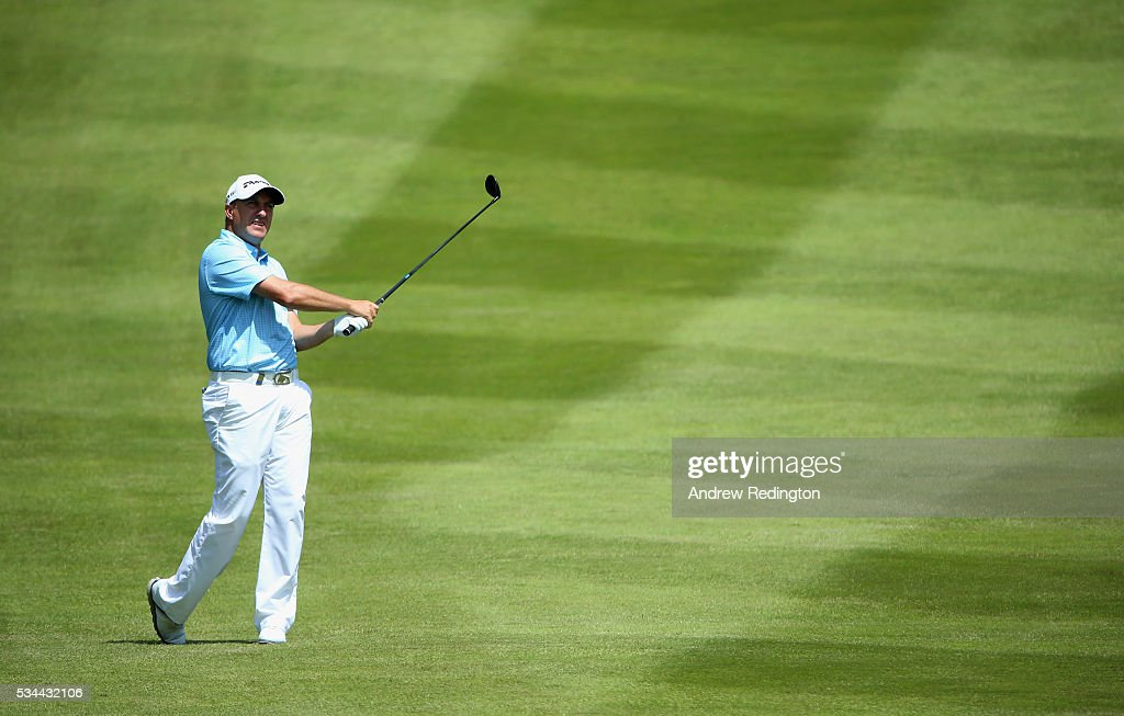 Darren Fichardt of South Africa hits his 2nd shot on the 4th hole during day one of the BMW PGA Championship at Wentworth on May 26, 2016 in Virginia Water, England.