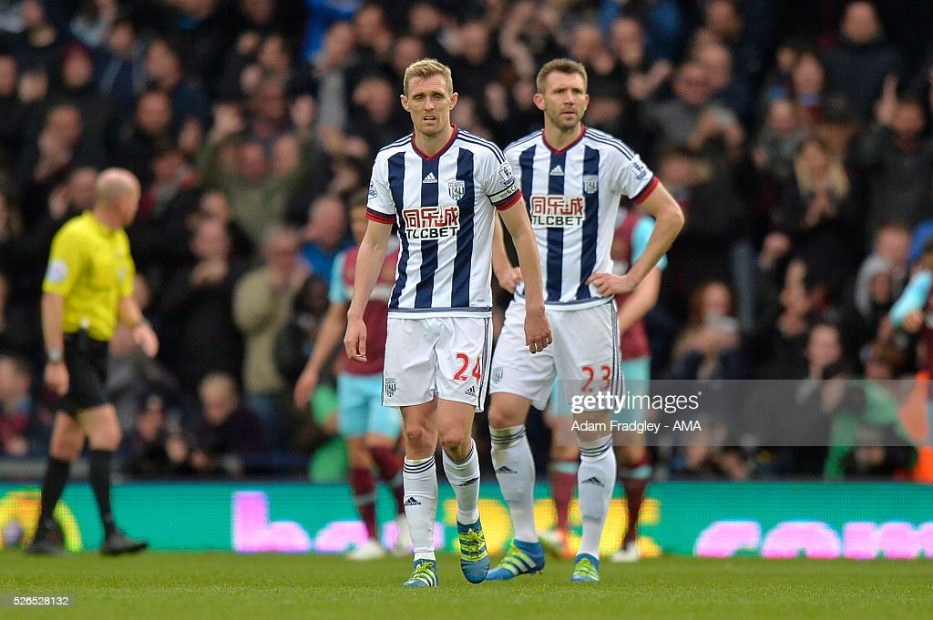 Darren Fletcher and Gareth McAuley of West Bromwich Albion look dejected during the Barclays Premier League match between West Bromwich Albion and West Ham United at The Hawthorns on April 30, 2016 in West Bromwich, United Kingdom.