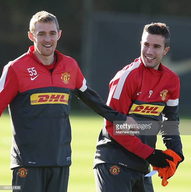 Darren Fletcher and Robin van Persie of Manchester United in action during a first team training session at Carrington Training Ground on November 2...
