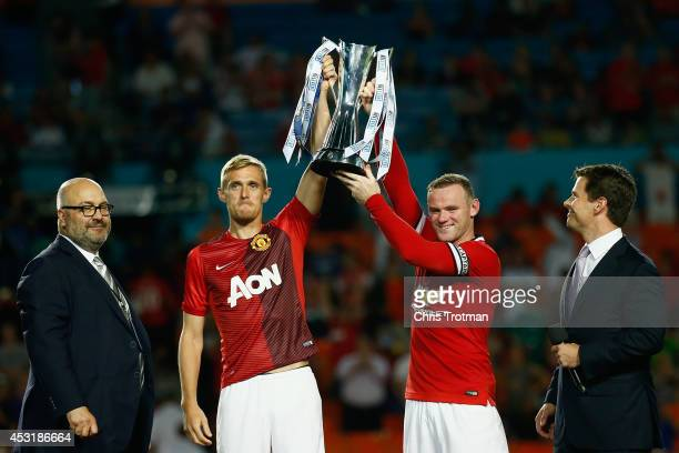 Darren Fletcher of Manchester United and Wayne Rooney of Manchester United lift the trophy following their 31 vicotory over Liverpool in the Guinness...