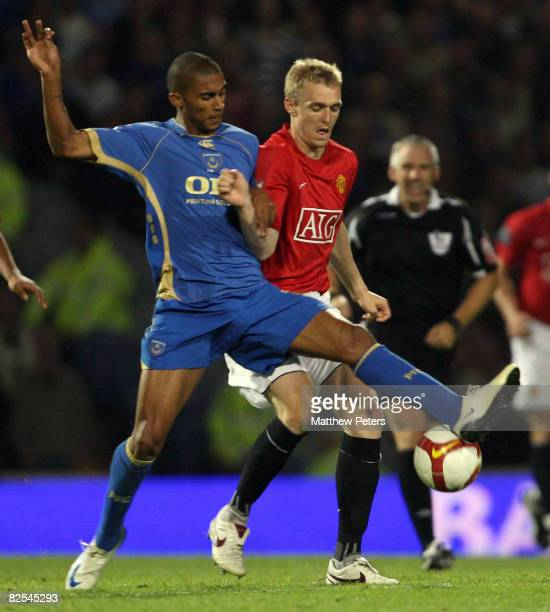 Darren Fletcher of Manchester United clashes with Armand Traore of Portsmouth during the FA Premier League match between Portsmouth and Manchester...