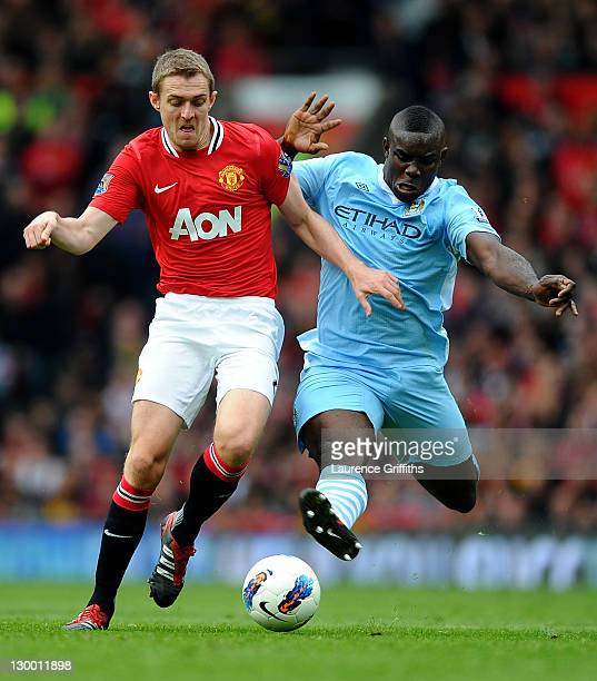 Darren Fletcher of Manchester United is challenged by Micah Richards of Manchester City during the Barclays Premier League match between Manchester...