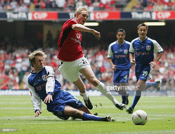 Darren Fletcher of Manchester United is tackled by Matt Lawrence of Millwall during the 123rd FA Cup Final between Manchester United and Millwall at...