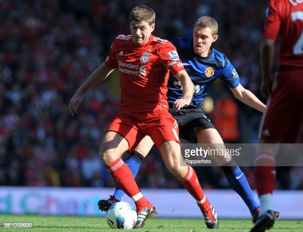 Darren Fletcher of Manchester United tracks Steven Gerrard of Liverpool during a Barclays Premier League match at Anfield on October 15 2011 in...