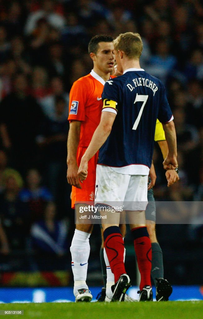Darren Fletcher of Scotland reacts with Robin van Persie of Netherlands during the FIFA 2010 World Cup Group 9 Qualifier match beteween Scotland and Netherlands at Hampden Park on September 9, 2009 in Glasgow, Scotland.