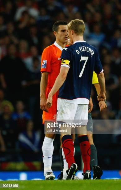 Darren Fletcher of Scotland reacts with Robin van Persie of Netherlands during the FIFA 2010 World Cup Group 9 Qualifier match beteween Scotland and...