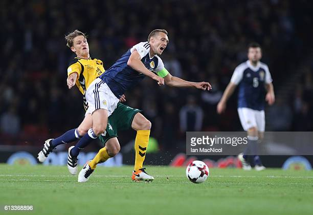 Darren Fletcher of Scotland vies Vykintas Slivka of Lithuania during the FIFA 2018 World Cup Qualifier between Scotland and Lithuania at Hampden Park...