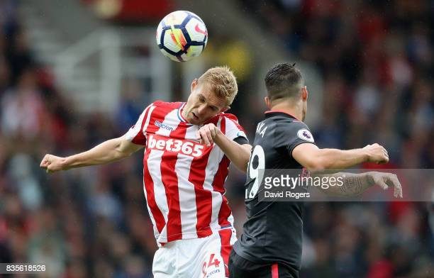 Darren Fletcher of Stoke City challenges Granit Xhaka during the Premier League match between Stoke City and Arsenal at Bet365 Stadium on August 19...