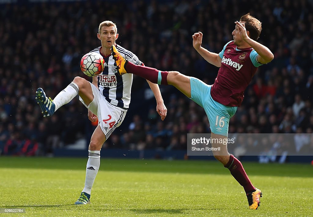 Darren Fletcher of West Bromwich Albion and Mark Noble of West Ham United compete for the ball during the Barclays Premier League match between West Bromwich Albion and West Ham United at The Hawthorns on April 30, 2016 in West Bromwich, England.