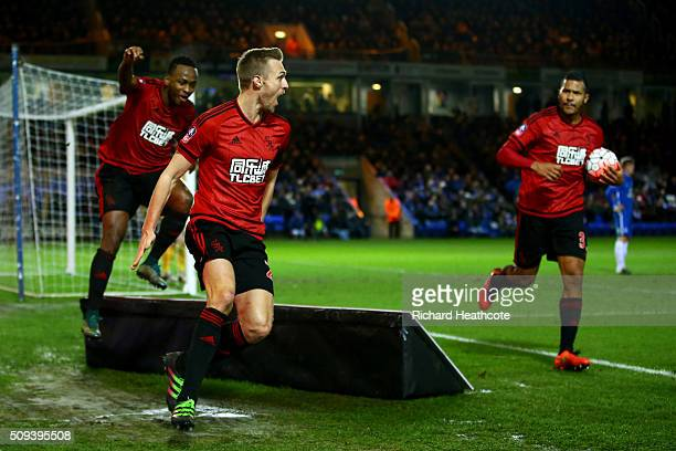 Darren Fletcher of West Bromwich Albion celebrates with teammates after scoring his team's first goal during the Emirates FA Cup fourth round replay...