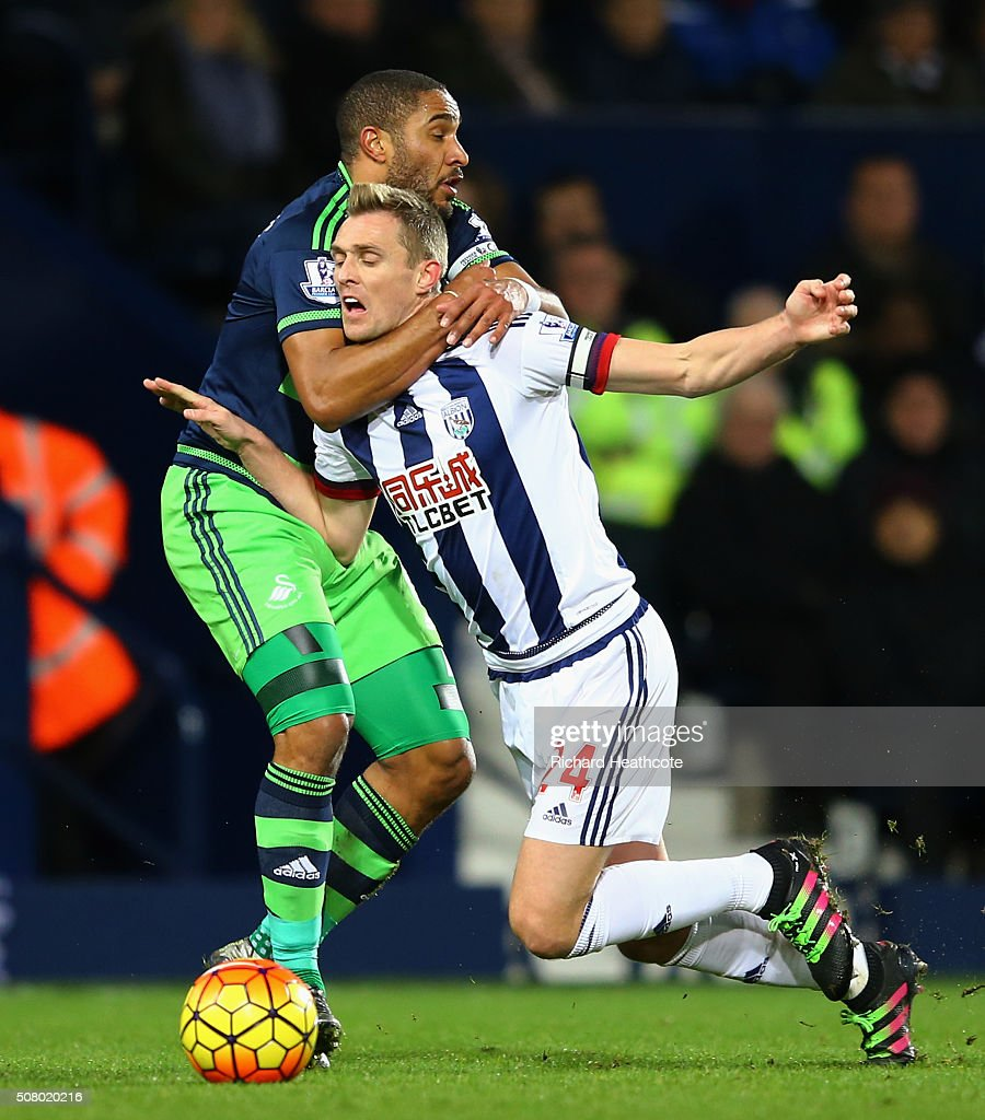 <a gi-track='captionPersonalityLinkClicked' href=/galleries/search?phrase=Darren+Fletcher&family=editorial&specificpeople=171310 ng-click='$event.stopPropagation()'>Darren Fletcher</a> of West Bromwich Albion is challenged by <a gi-track='captionPersonalityLinkClicked' href=/galleries/search?phrase=Ashley+Williams+-+Voetballer&family=editorial&specificpeople=13495389 ng-click='$event.stopPropagation()'>Ashley Williams</a> of Swansea City during the Barclays Premier League match between West Bromwich Albion and Swansea City at The Hawthorns on February 2, 2016 in West Bromwich, England.