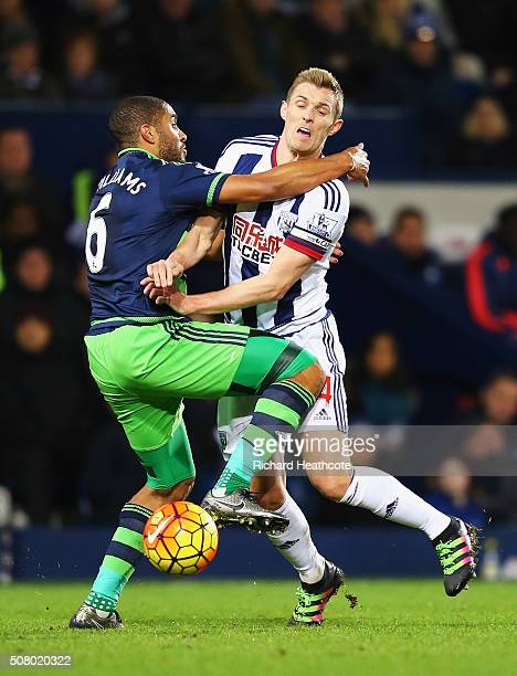 Darren Fletcher of West Bromwich Albion is challenged by Ashley Williams of Swansea City during the Barclays Premier League match between West...